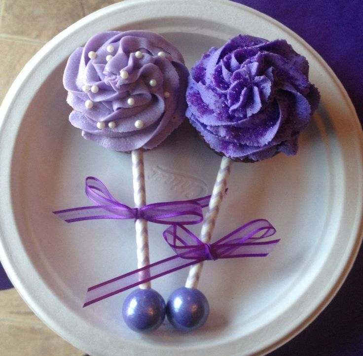 Baby Rattle Cupcakes Lavendar Cream Cheese Frosting, Purple Buttercream frosting, striped straw/sticks, Bubble Gumball on the end