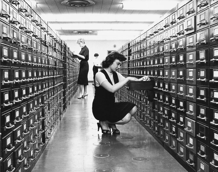 looking for a book at the library back in the day...Dewey Decimal Card File System.