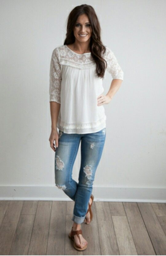 I like the 3/4 sleeve length and lacy detail of the top