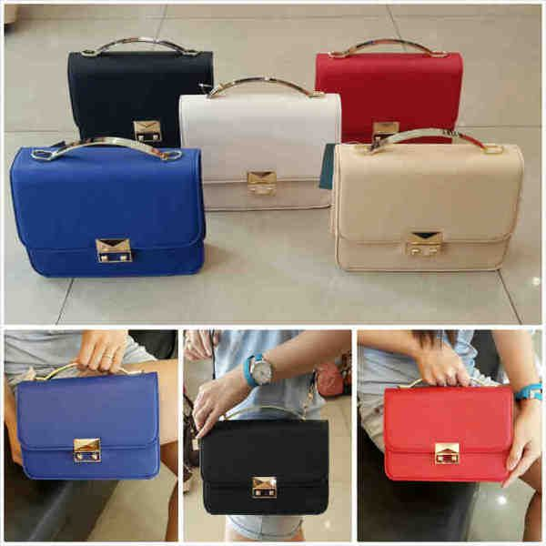 CHARLES & KEITH TOP HANDLE 687 SEMI ORI sz.24X8X18 BH. KULIT TAIGA. IDR 290K. colors: blue, black, red, apricot, white. cp Risa - 089608608277