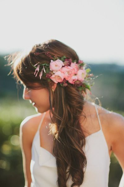 side ponytail curls with flower