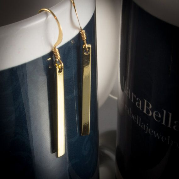 Our gold plated vertical bar drop earrings are a beautiful and elegant design. Our gold plated bar earring should be the mainstay in all jewelry collections as they have the versatility to be paired up with most any jewelry item you choose to wear. Stunningly elegant! (These earrings also come in silver - see link below)   614924EG - Silver https://www.etsy.com/ca/listing/204255609/rhodium-plated-vertical-bar-drop