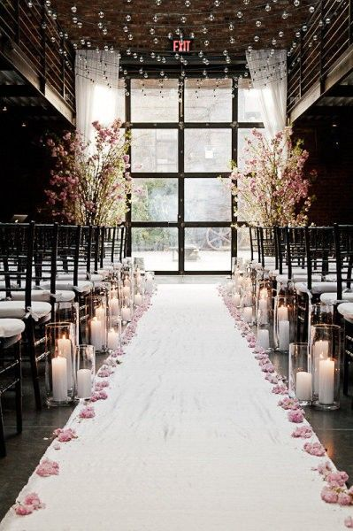 Ceremony decor-Cylinders all have floating candles and navy blue water. Rose petals will be ivory