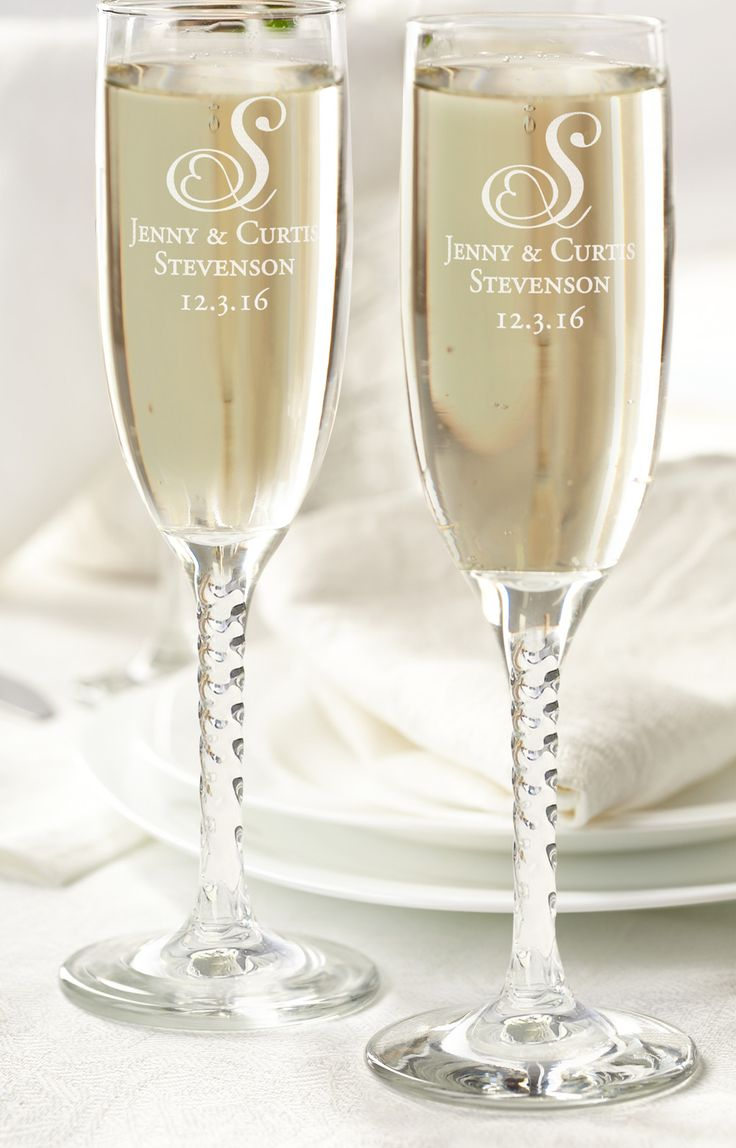 """Toast to love and happiness with these classic champagne flutes. They can be personalized for that individual touch. Glasses are sold in sets of two, hold 5.75 oz and measure 8"""" tall."""