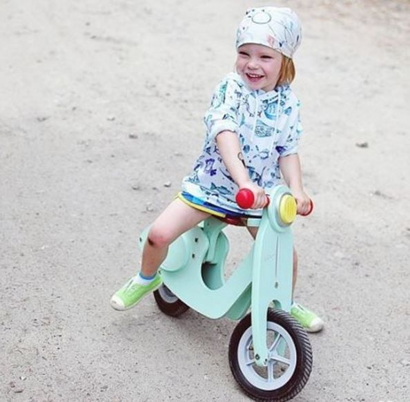 The ultimate summer toy is the green wooden scooter by Janod! Enjoy the ride!