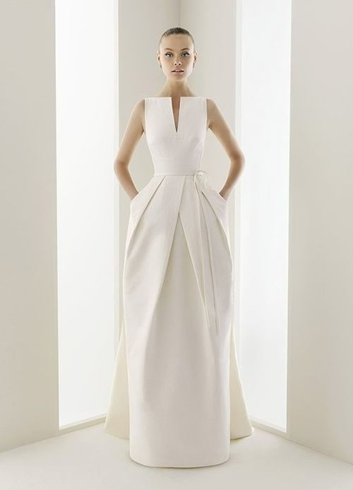 An amazingly structured dress! Love the high neckline.