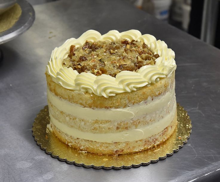 """Lane Cake Recipe (Pic 13 of 17)  _ An Alabama favorite, comes back into fashion in part because of novelest, Harper Lee. The Lane cake is credited to Emma Rylander Lane of Clayton, Ala., who in 1898 published """"A Few Good Things to Eat."""" See: Southern cookbook writer - Chef Edna Lewis' recipe! The filling combines eggs, pecans, vanilla extract, coconut, & raisins with butter & sugar."""