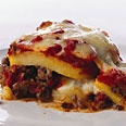 """Lamb and Polenta """"Lasagne"""". This is WAY tastier than that photo would indicate:) I usually add rosemary or oregano to the lamb with the allspice. Even better with smoked mozzarella (sliced if you have fresh cheese), if you can find it. Method: Use leftover polenta molded in a loaf pan and sliced; the layers fit the lasagna pan better than the storebought polenta rolls (those work fine, too, though). Also, do take care to cook the sauce down a bit; too much liquid makes things a bit mushy."""