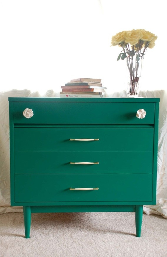 I like mid century modern wood furniture pieces, but not so much upholstered pieces... This one is painted a lovely teal!