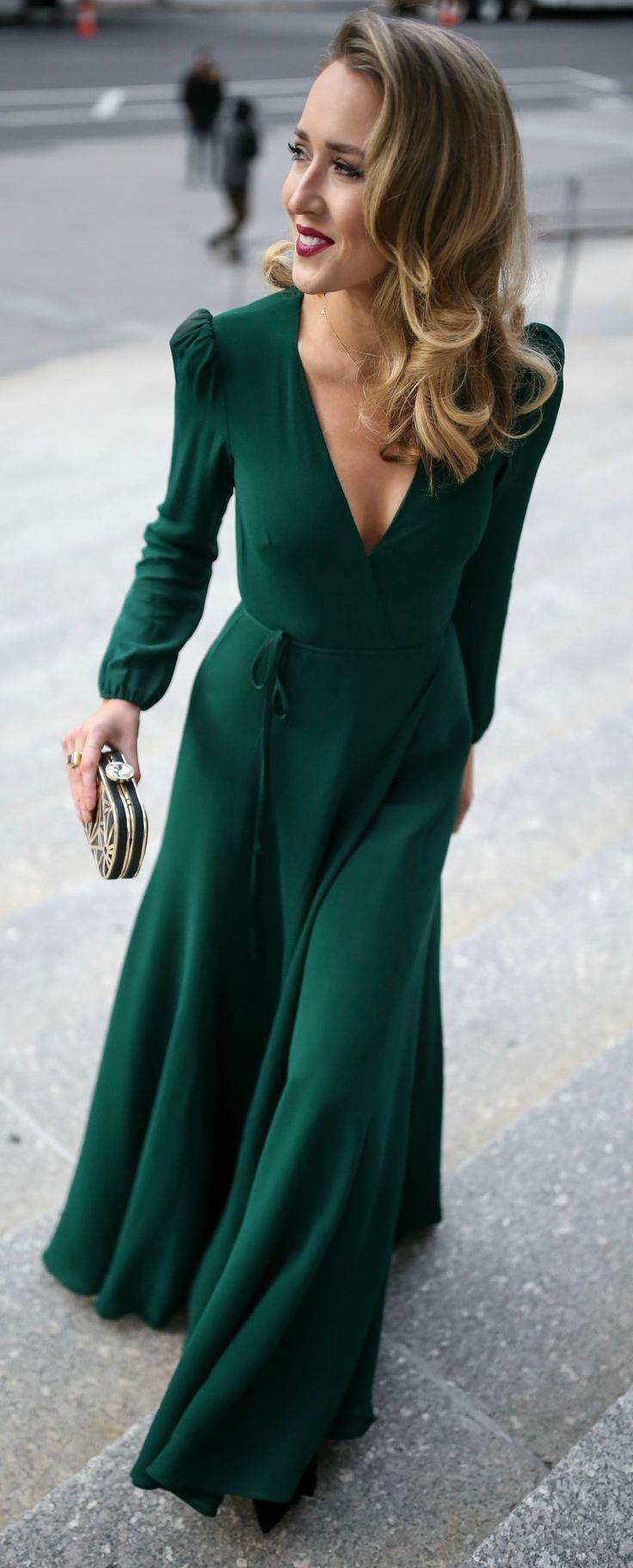 Emerald green long-sleeve floor-length wrap dress, black and gold geometric pattern evening clutch, multicolor beaded statement earrings, black velvet kitten heel pumps with bow detail {Miu Miu, Zara, Reformation, black tie wedding, formal wedding guest,