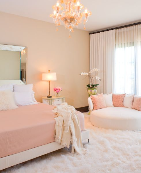 Tuscan Oasis | blush pink, cream and white luxury bedroom with beautiful lighting and huge fur rug