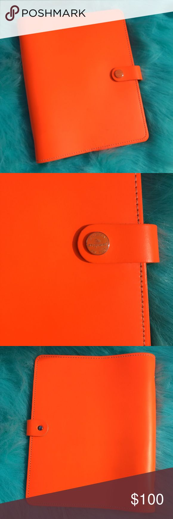 "Filofax A5 original in Fluro orange Filofax, the original organizer, in Fluro orange. Real leather. A5 size. This color is bright and glorious- much brighter in person! Has been used with minor signs of wear. I tried to show minor wear in last photo and inside leather. Can continue to be loved for years to come! Planner comes as is- no inserts, but can easily buy refills online. Height: 9.25"", Width: 7.52"", Depth: 2.17"", leather closure strap with branded popper, Ring Mech: 1"". Thanks for…"