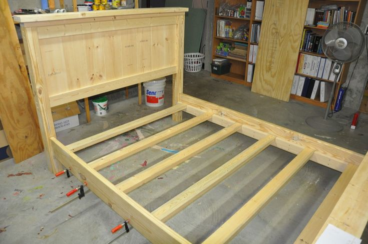 Unfinished bed frame with rails and supports... part 2 attaching the bedrail accessories
