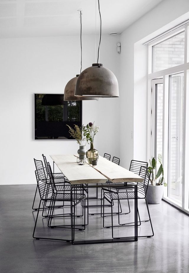 Minimalist dining table with wireframe chairs.