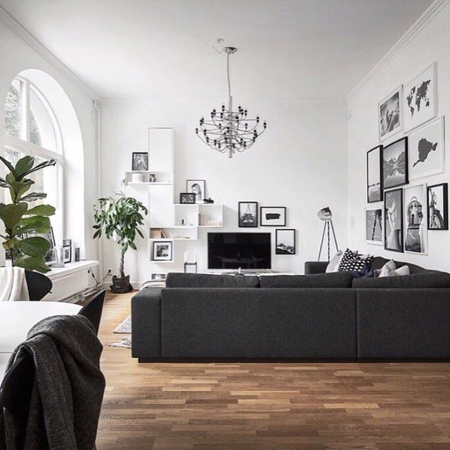 Black, white, wooden floorboards, chandelier, open shelving, gallery wall, what more could you want? Get the look with the LAITURILLA print - limited stock left!