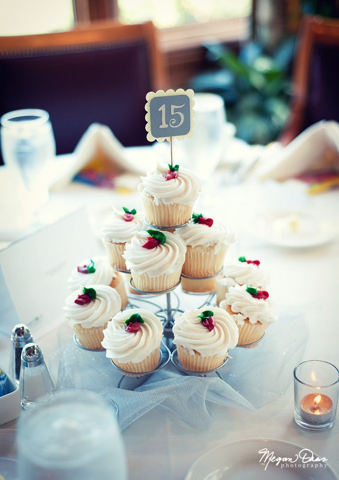 Adorable cupcakes for centrepieces! And a way to display the table numbers at a wedding