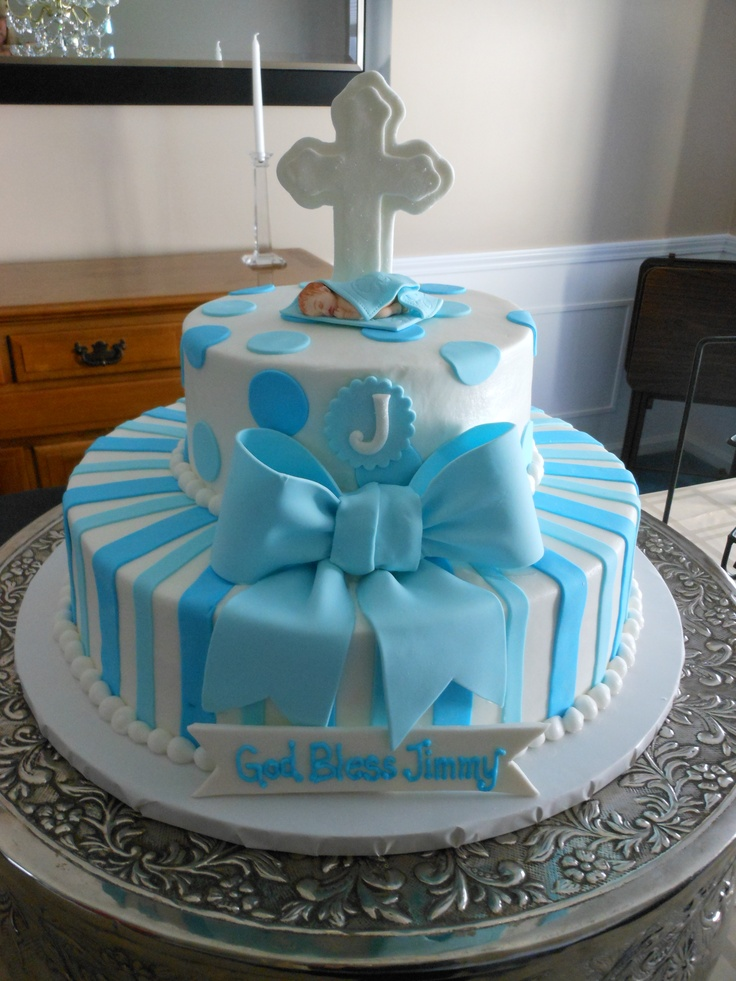 "Cole's Baptism Cake....bottom layer instead of solid blue stripes, marbled blue and white stripes. Top layer quilted instead of dots. Instead of J an oval plaque with ""Cole""...no bow"