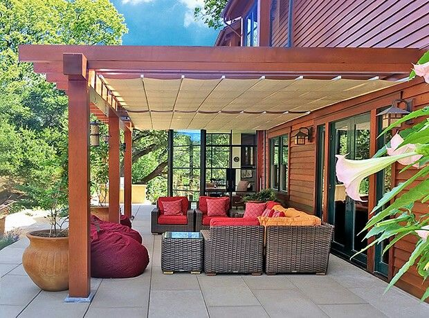 What we want for our pergola. Just needs a way to attach clear, heavy plastic in cooler weather to act as a sunroom.