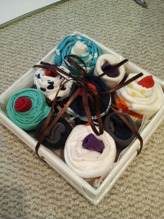 Baby Shower cupcakes (burpcloth with sock in the middle).