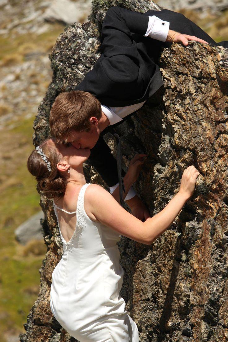 Bride Amy and groom Casey rock climbing on their wedding day. #adventurewedding #realwedding #queenstownwedding #newzealandwedding #brideandgroom #weddingkiss #weddingceremony #outdoorwedding #summerwedding #mountainwedding  #rockclimbing #bouldering #bridaldress #weddingdress #weddingphotography #queenstown #yourbigdayqt #queenstownmarriagecelebrant #yourbigdayyourway #lovemyjob