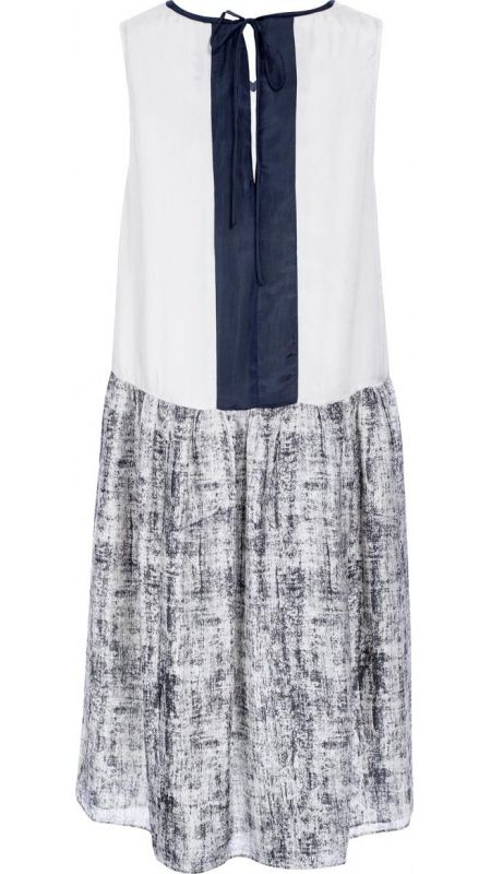 """</p> <p style=""""line-height: 11.85pt; font-size: 12.16px;"""">Mid-length sleeveless V neck dress in printed silk.</p> <p style=""""line-height: 11.85pt; font-size: 12.16px;"""">Silk binding around neckline in charcoal.</p> <p style=""""line-height: 11.85pt; font-size: 12.16px;"""">Centre front panel in liquen with front side panels in charcoal and liquen pattern.</p> <p style=""""line-height: 11.85pt; font-size: 12.16px;"""">Large pockets on lower sides of skirt panels in charcoal.</p> <p style=""""line-height…"""