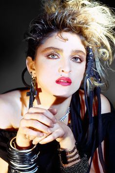 Madonna had a major impact on the influence of fashion in the 1980's. She made her fame in the mid-1980's. The style of the 1980's were inspired by celebs like Madonna with tulle skirts over leggings, bustier tops, beaded necklaces, giant hair bows, fishnet gloves and many bangles, as well as giant earrings. No matter what she was wearing she was a fashion leader.