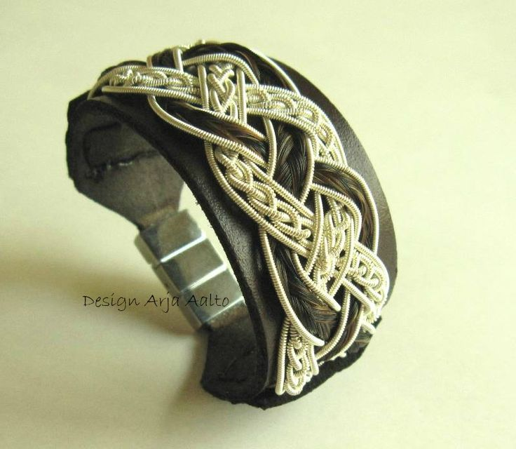 Horsehair wrist cuff. Made of leather, horsehair and coiled Sterling Silver.
