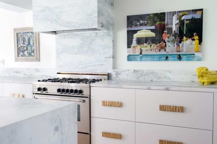 How to Create A Stylish & Kid-Friendly Home   Interior design by Denise Davies of D2 Interieurs   Photo by Denise Davies   Kid-Friendly Home   Family-Friendly Home Design   Home Decor Inspiration   Interior Design Inspiration   White Kitchen   Marble Kitchen Hood   Marble Kitchen   Gray and White Marble   Glamorous Kitchen   Gold Kitchen Pulls   Kitchen Design Ideas   Kitchen Inspiration   Kitchen Seating   Modern Sanctuary   Modern Kitchen Ideas  Modern Kitchen Inspiration   White...
