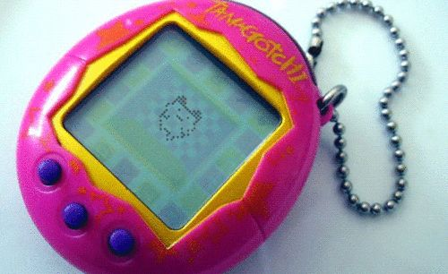 The frustration of trying to keep your Tamagotchi alive. | 36 GIFs That Will Immediately Take You Back To Your '90s Childhood