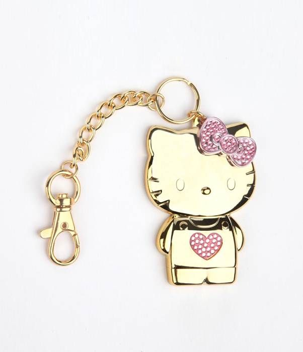 Charm the birds from the trees with this goldtone and rhinestone #HelloKitty bag charm