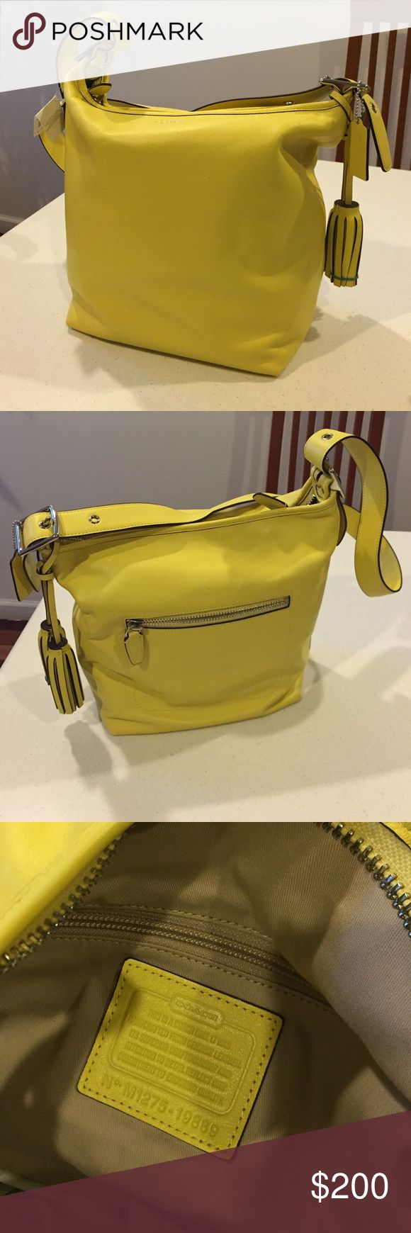 NWT Coach Legacy Leather Duffel Bag Lemon NWT Coach Legacy Leather Duffel Bag Lemon. Has small light dot on the side of the bag. Not noticeable. Straps are adjustable. Tassels are in perfect condition. Comes with dust bag. Beautiful yellow color. Coach Bags Crossbody Bags