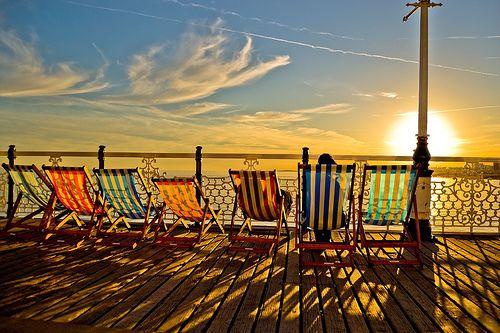 Deckchairs on Brighton Pier, UK.