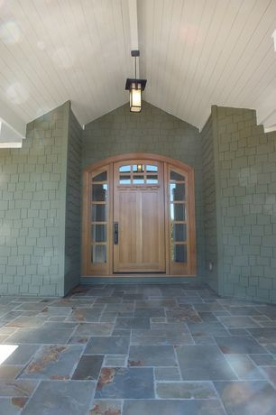 Transitional Front Door with exterior tile floors