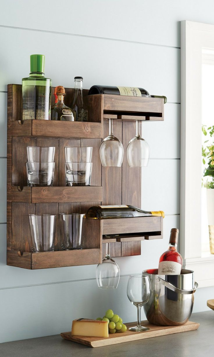 This is a cool wine and liquor bottle rack. Stand the bottles up or lay them down in the perfectly sized holders while keeping up to four wine glasses on hand and ready to use. Store your favorite wine or liquor bottles in style. #rustic #farmhouse #homedecor #walldecor #affiliate #storage #wine ##liquor