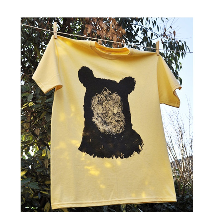 T-shirt by illustrator and designer Ben Phe. Ben's illustrative style usually translates onto glass, but has transferred his hand-drawn designs onto these t-shirts from his piece called 'Bare-Face'.