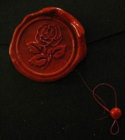 5 wax seals,  for the 5 mafia families. red