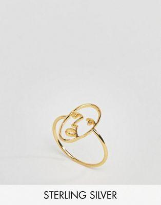20a5eb38d431 Anillo de plata de ley chapado en oro con diseño de cara de ASOS ...