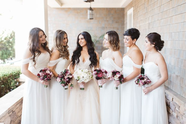 Whimsical White Bridesmaids Dresses and Bold Bouquets  Venue: Montage Laguna Beach Photographer: Brandon Kidd Photography