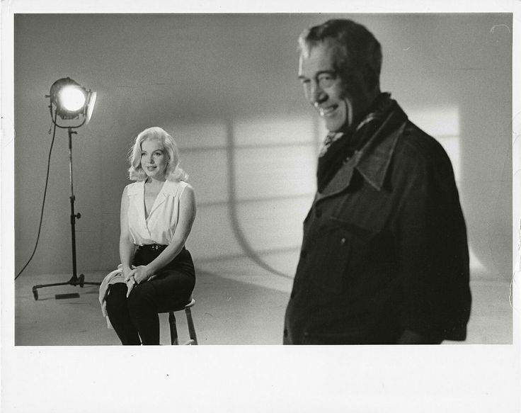 Marilyn with director John Huston during tests for The Misfits, 1960.