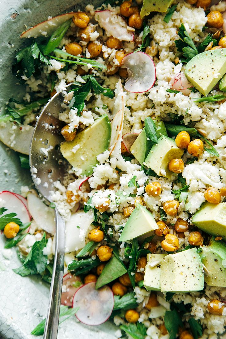 "cauliflower + roasted garbanzo ""rice and peas"" with avocado, apples, radishes, herbs"
