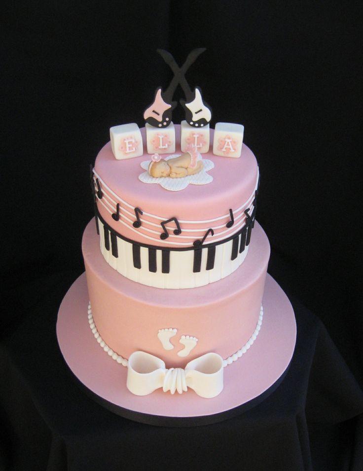 "Music baby shower cake- 7"" fondant/9"" buttercream- vanilla cake with raspberry filling and white chocolate buttercream."