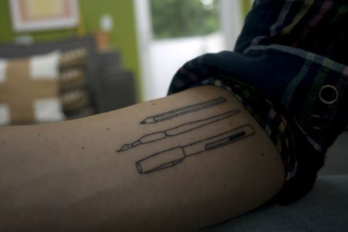 Cool tattoo idea for an artist, maybe add a  paintbrush or pallet of paint for color splash.