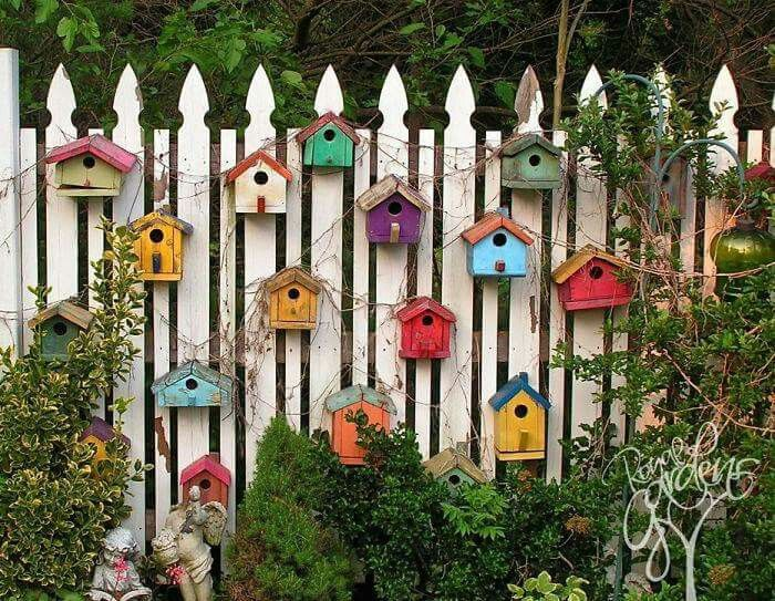 Think Im going to do this to my fence. Birdhouses…