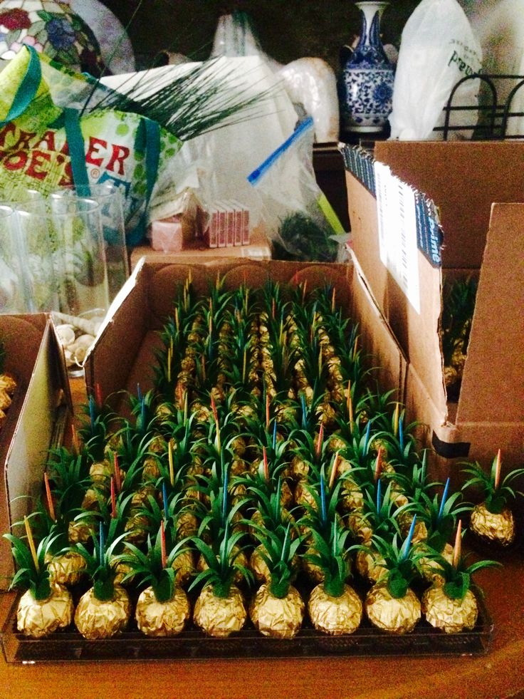 Behind the scenes look at our escort cards to fit our fun Hawaiian theme wedding: Ferrero Rocher turned into pineapples!
