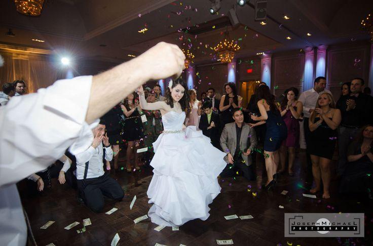 Hazelton Manor Wedding Photography Greek Dancing, Bride in the middle of the dance floor dancing, Greek Bride dance, Money on floor, Graffiti gun