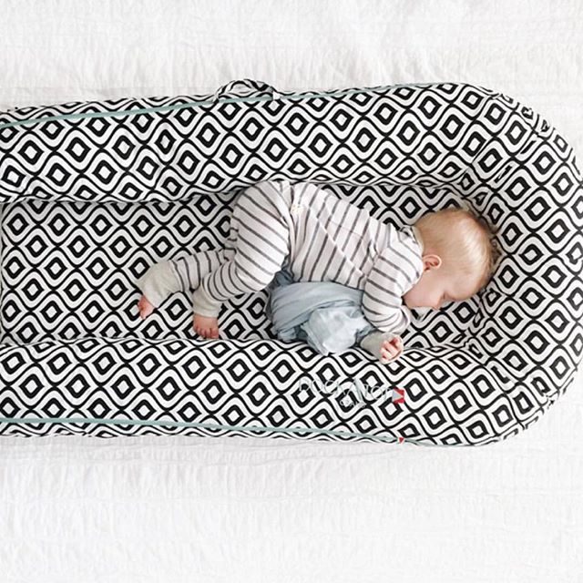 Some serious nap time going on here. This cutie is snoozing away in a DockATot Grand portable baby bed/baby lounger. For more info on this must have baby gear and to buy, visit dockatot.com
