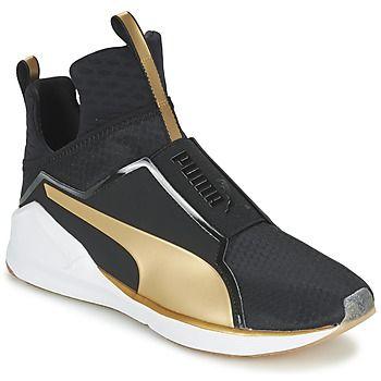 Previsão de altas temperaturas para esta estação à escala da moda pela Puma previna-se com estas sapatilhas. Confortável e tendência, associa gáspea em  e cor preta. Seu forro em tecido associa-se a uma sola em borracha.   Então, dizem que sim? - Cor : Preto / Ouro - Sapatos Mulher 103,00 €