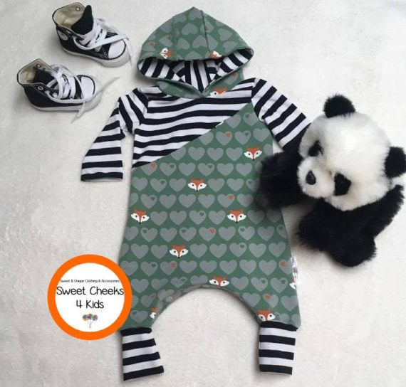This sweet little hooded harem romper will be perfect for your new baby boy or girl or as a gift for a baby shower. With shades of green hearts and sweet little foxes, it's the cutest choice for a special baby. Babies love to be snuggled and the hood keeps them cozy. The crotch is made with plastic snaps to allow for easy dressing and diaper changes.