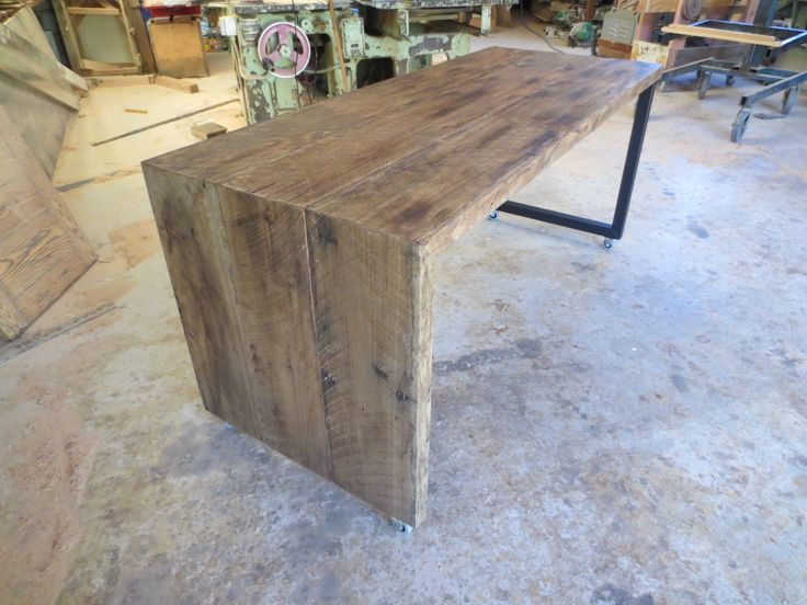 Bespoke Kitchen table that slides away into kitchen bench to be stored. Buy Direct from Christoper Bennell, the craftsman.  02 4632 7699