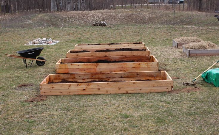 Simple DIY large raised garden beds guide. I made each of these 4' x 10' cedar raised garden beds this spring to add more gardening space.